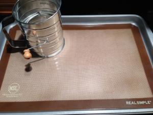 sifter, silicone mat, and baking sheet